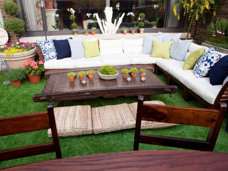 backyard patio with white sectional and wood coffee table e1456721675922