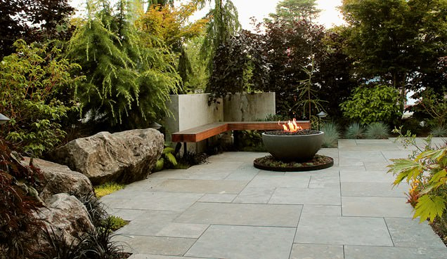 Boulder-seating-limestone-patio-firebowl-cedar-bench-green