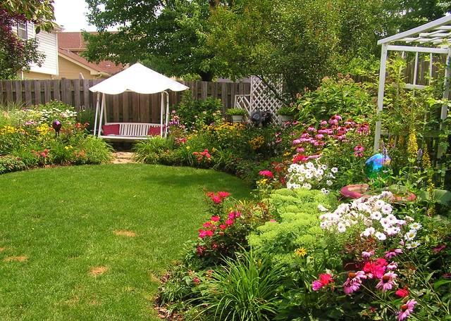 Backyard-Swing-in-Perennial-Garden-traditional-landscape