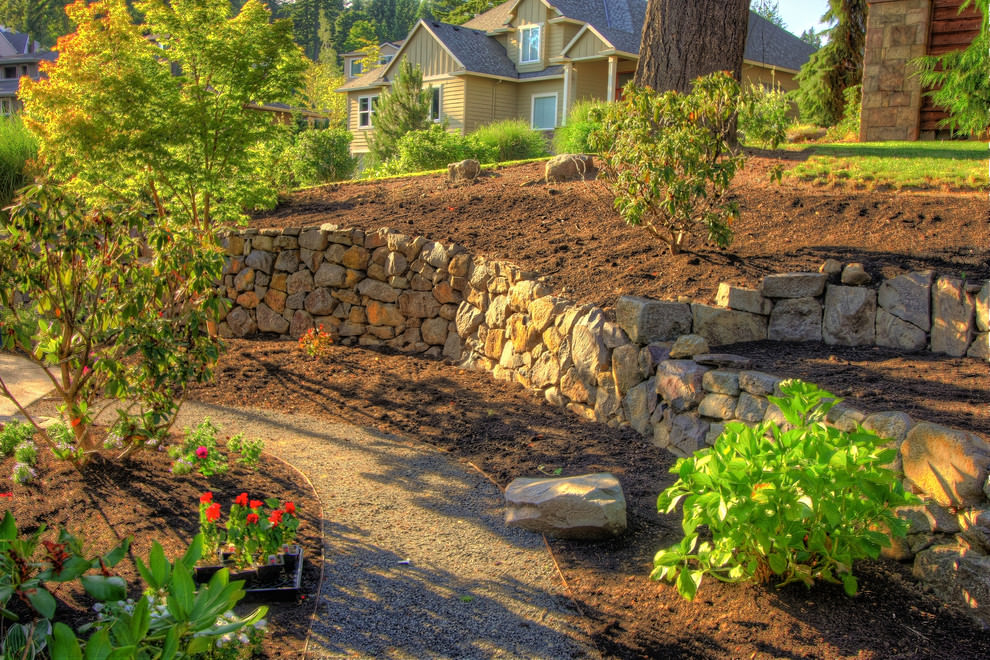 Rock Wall Garden Designs diy homemade gabion wall ie rocks encased in wire baskets and used as a retaining wall creates a dramatic feature in a garden no directions on link 24 Rock Wall Garden Designs Decorating Ideas Design Trends