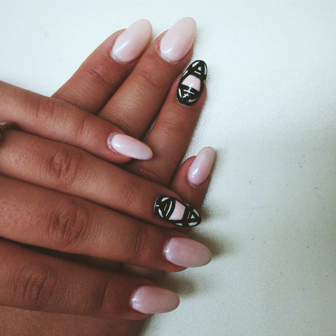 black designed light pink nails