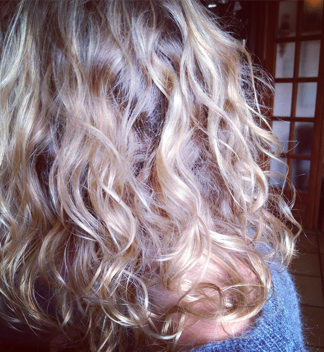 blond wave curly hairdo