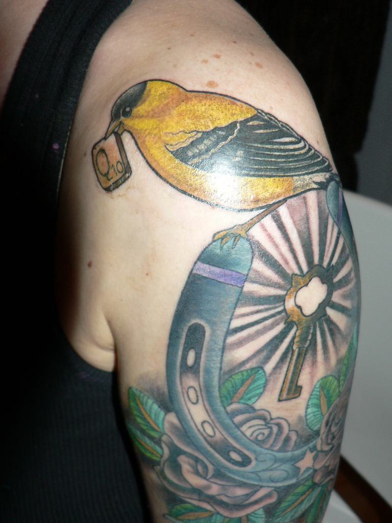 bird and key arm tattoo