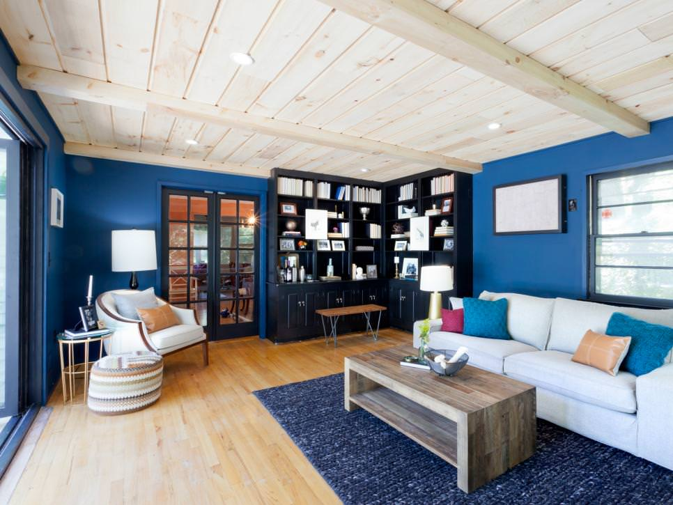 Blue Living Room With Black Corner Bookcases