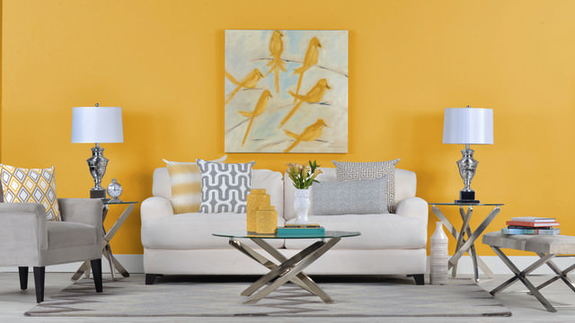 Yellow colored wall with art living room