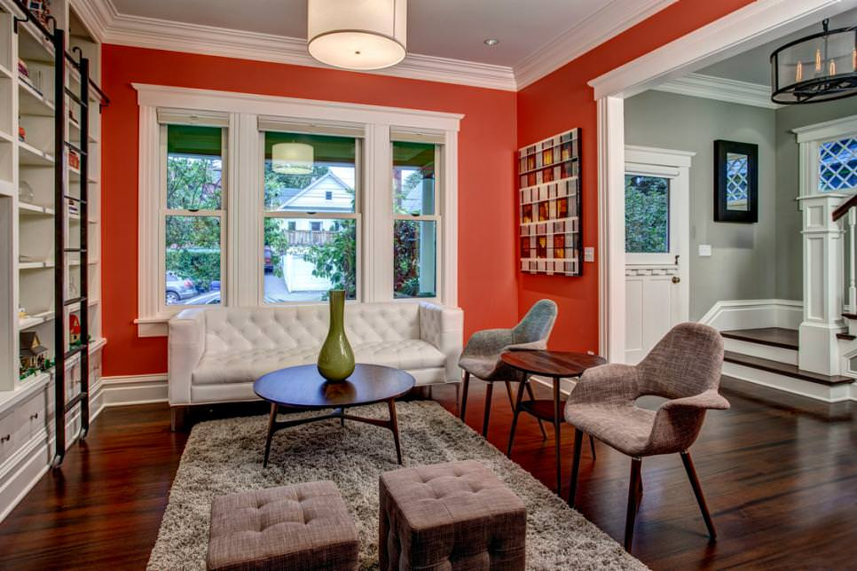 Bold Orange Living Room With Crisp White Trim
