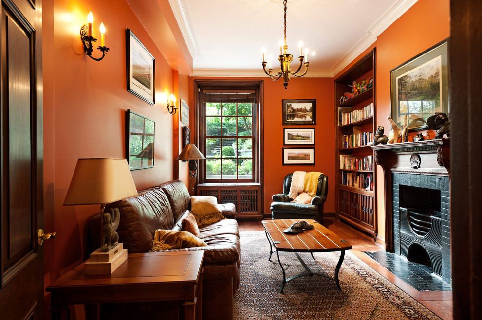 Bold orange traditional family living room