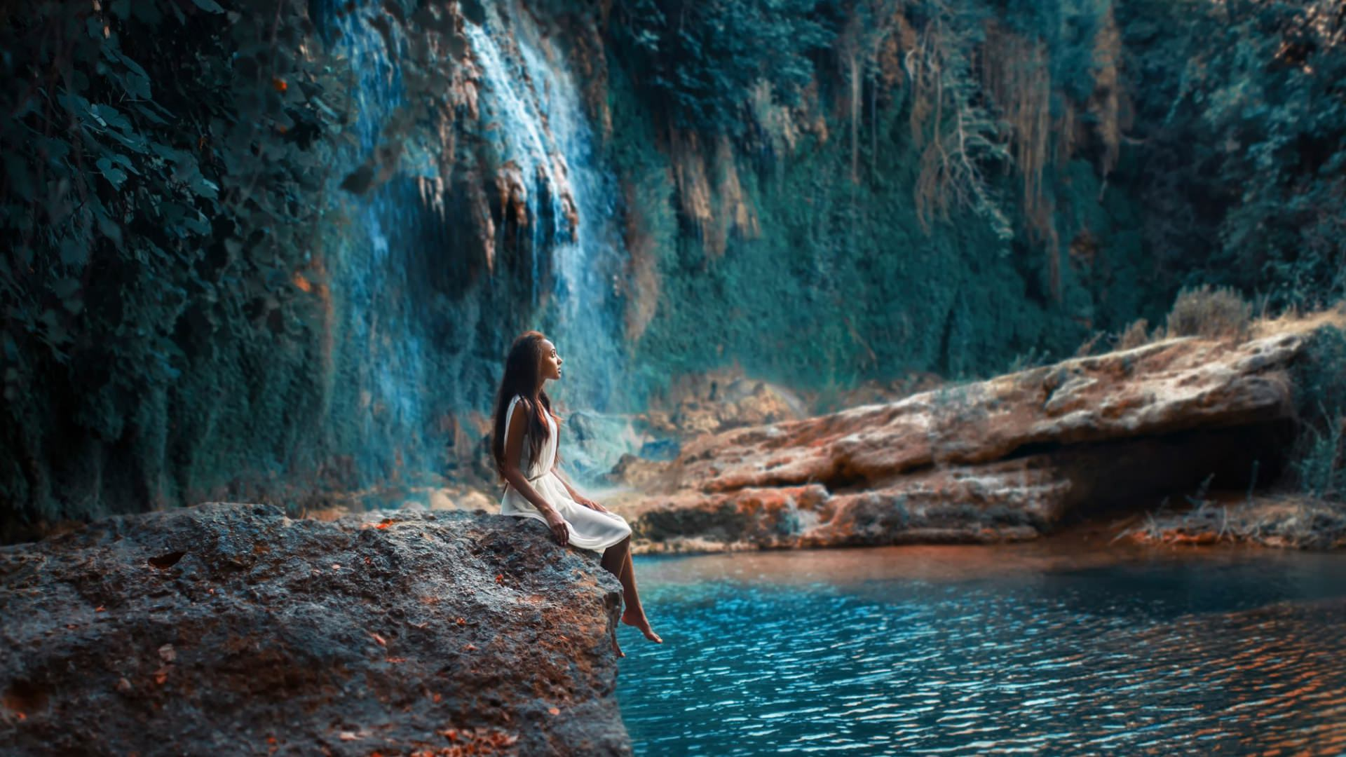 Girl Sitting at Waterfalls