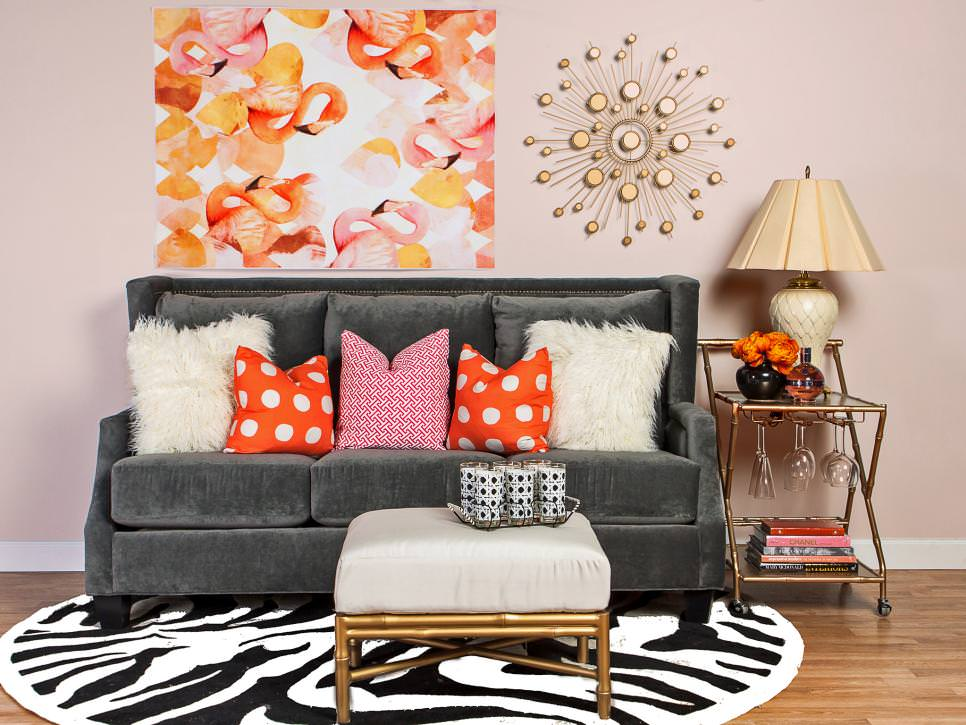 glam pink living room with flamingo art and gray sofa