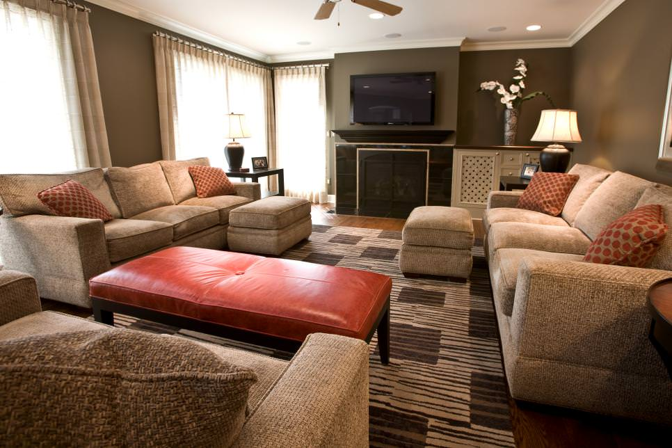 Burnt Orange Accents Pop in Brown Living Room
