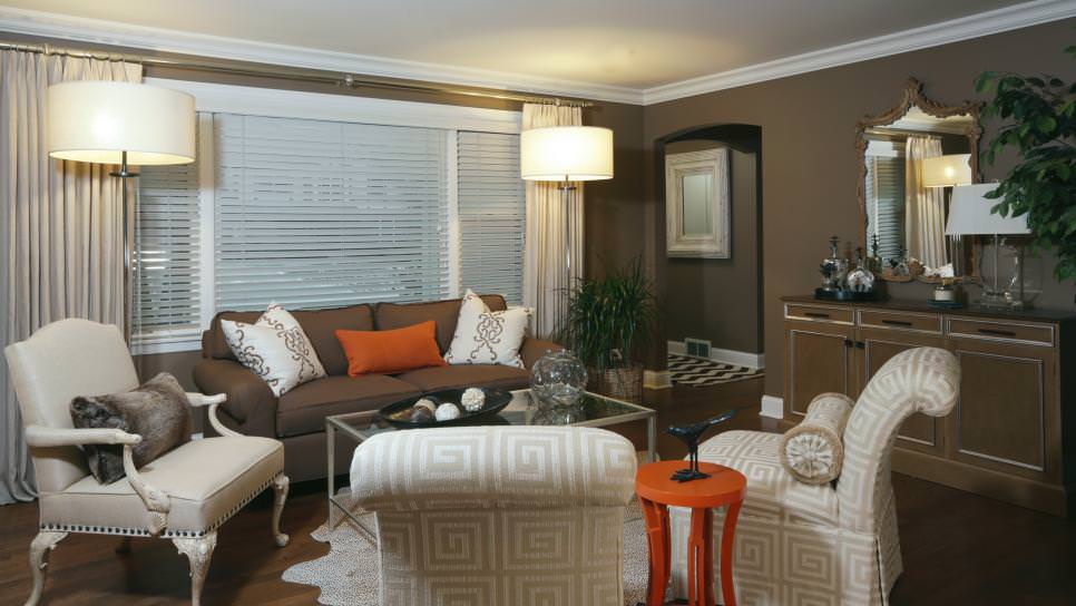 Orange Accents Brighten Brown Living Room