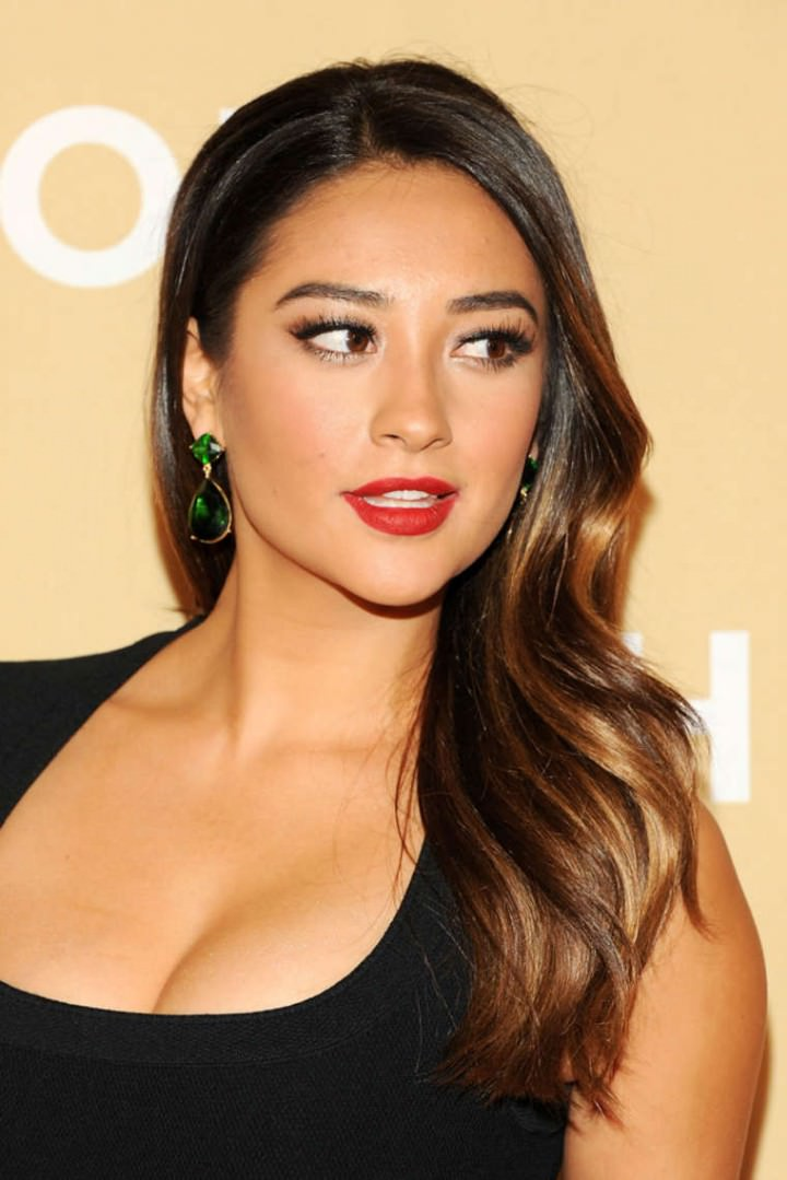 Shay Mitchell with hair side trucked behind the ears