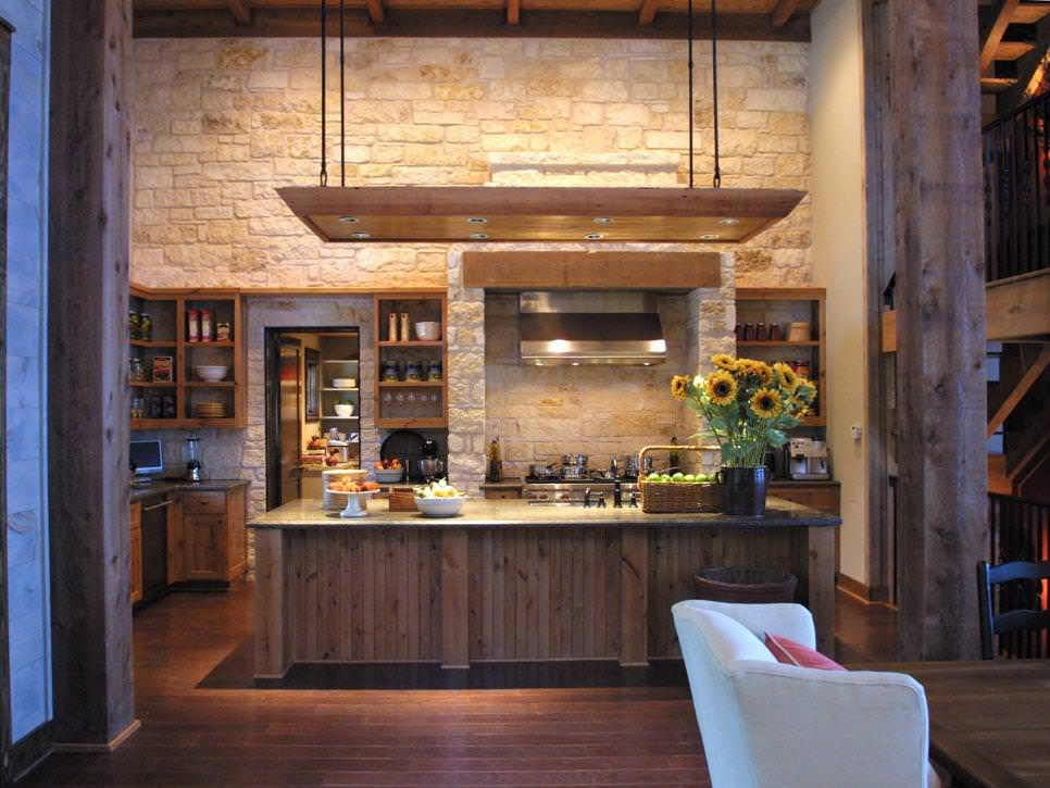 Neutral Rustic Kitchen With Stone Wall