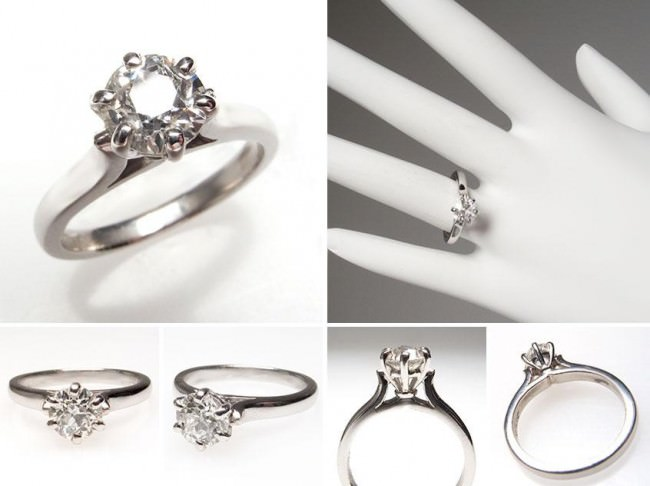 Lovely old European diamond engagement ring is crafted of solid platinum