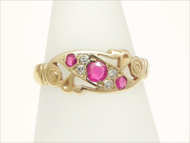 ruby pink diamond cluster with three stones