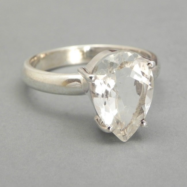 sterling silver ring set with white topaz pear shaped e1459920724470