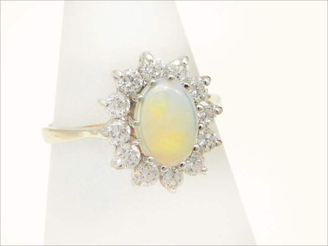 Vintage opal cluster ring set in 9K gold