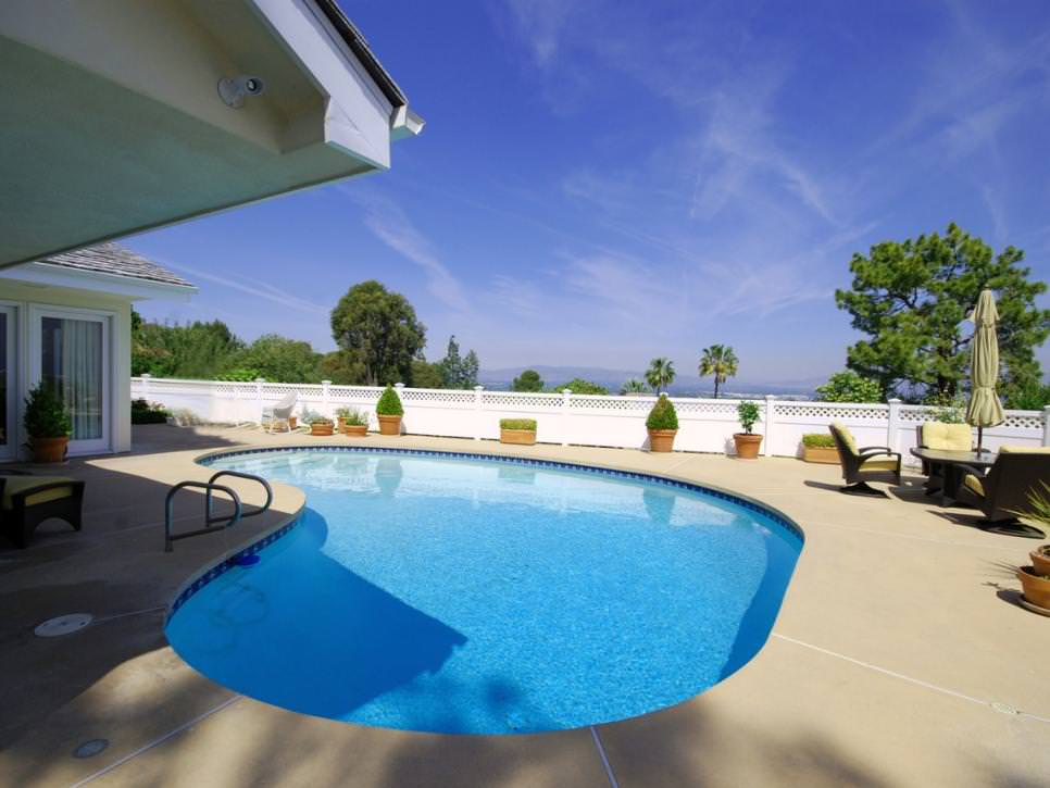 large concrete patio poolside