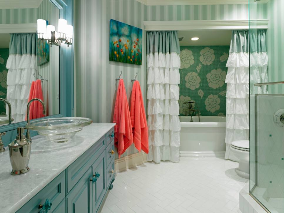 Blue Bathroom With Striped Walls and Ruffled Curtains