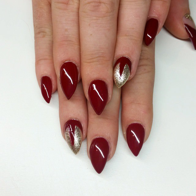 dark red short stiletto nails