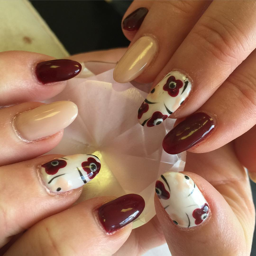 Dark Red Oval Nail Design
