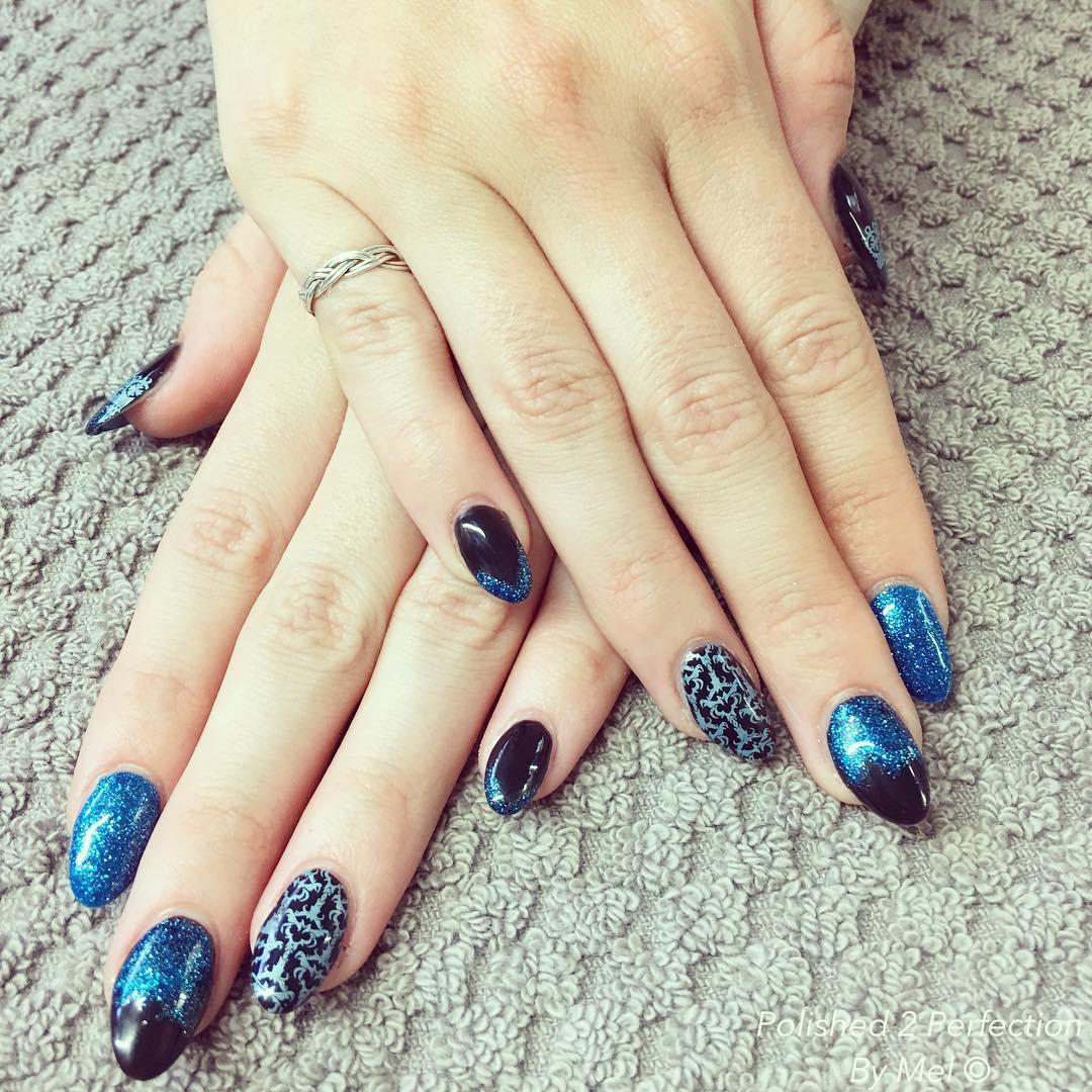 blue black oval nail design