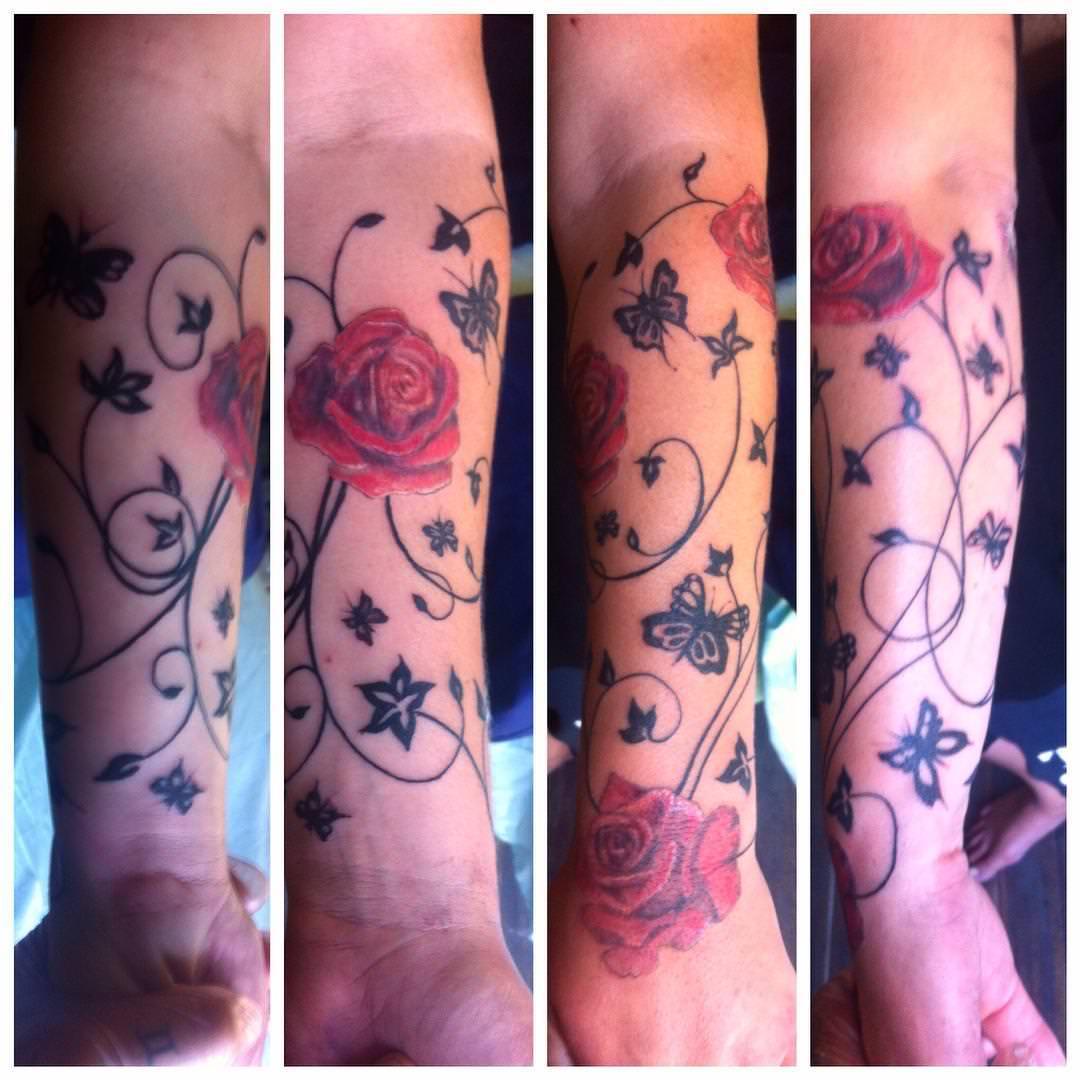 rose flower forearm sleeve tattoo