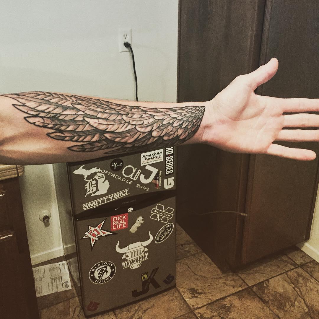 wing forearm sleeve tattoo