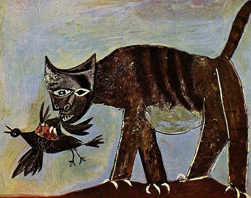 cat catching a bird
