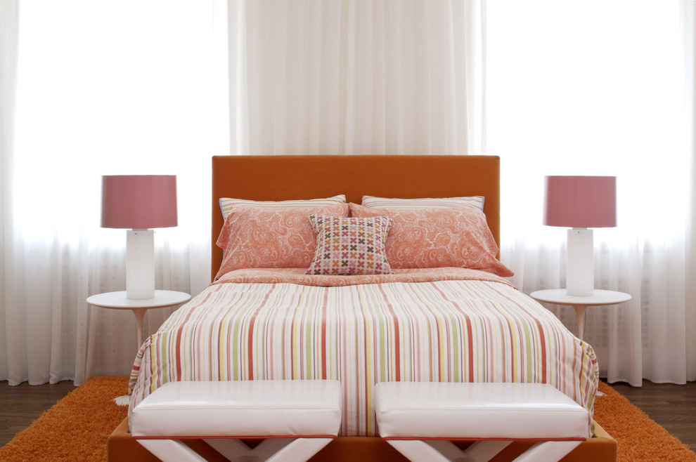 vibrant orange bed in bedroom