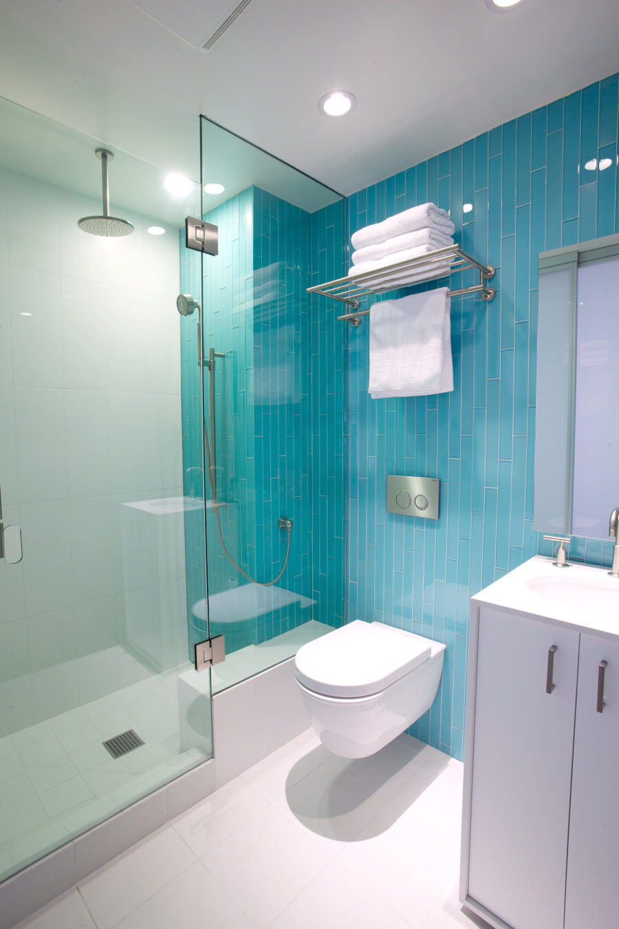 turquoise master bathroom with glass enclosed shower