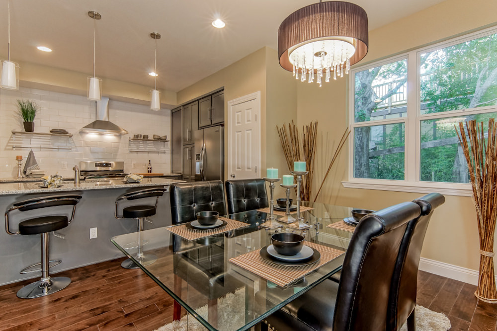 Transitional Kitchen With Glass Dining Table