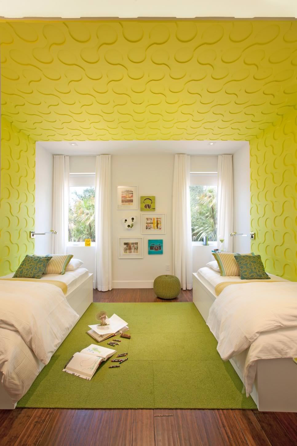 Twin beds with green walls