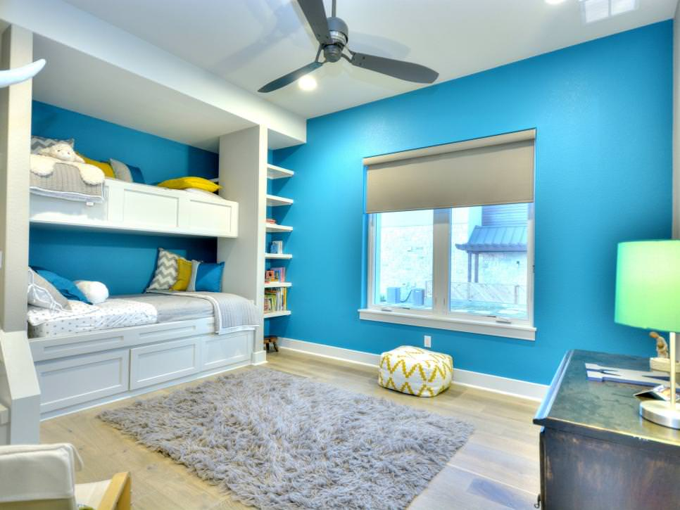 bright blue kids room with built in bunk beds