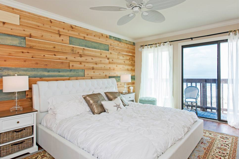 master bedroom with a feature wood wall design