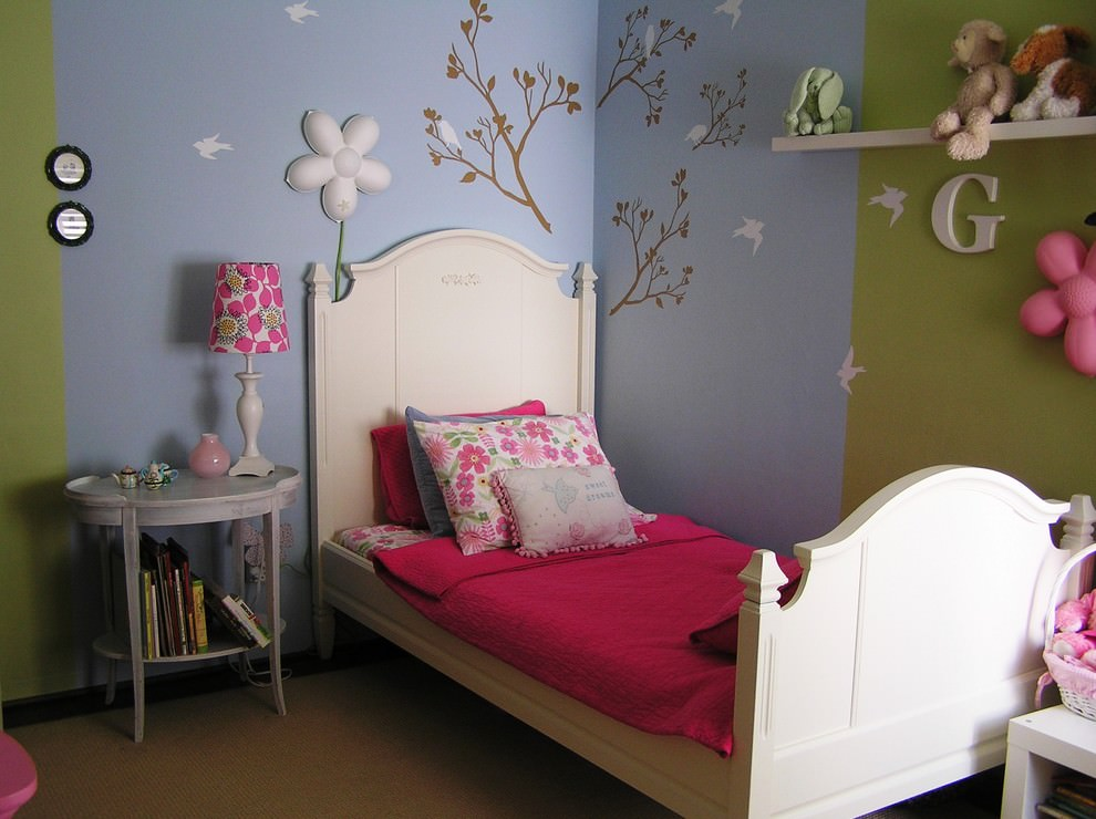 Eclectic kids bedroom with flower design on wall