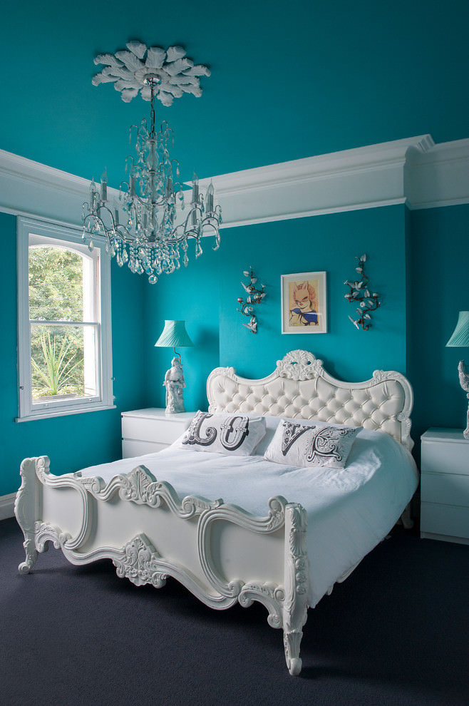 eclectic bedroom with vibrant blue wall design