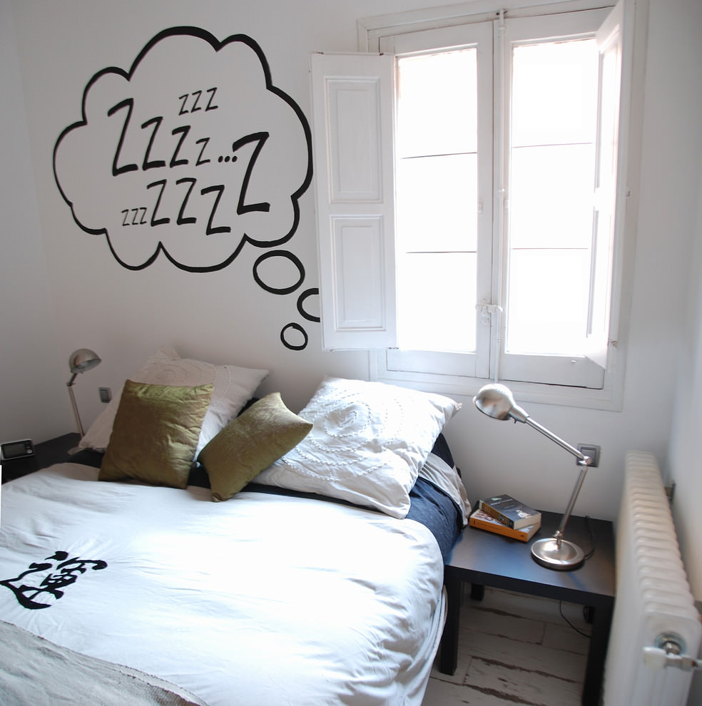 white bedroom with letters wall design