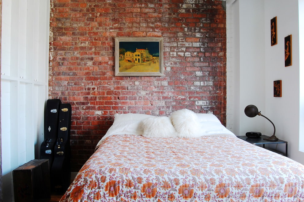 industrial style bedroom with brick wall