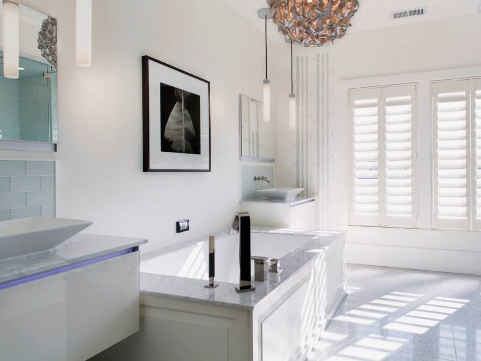 Crisp White Bathroom With Contemporary Chandelier