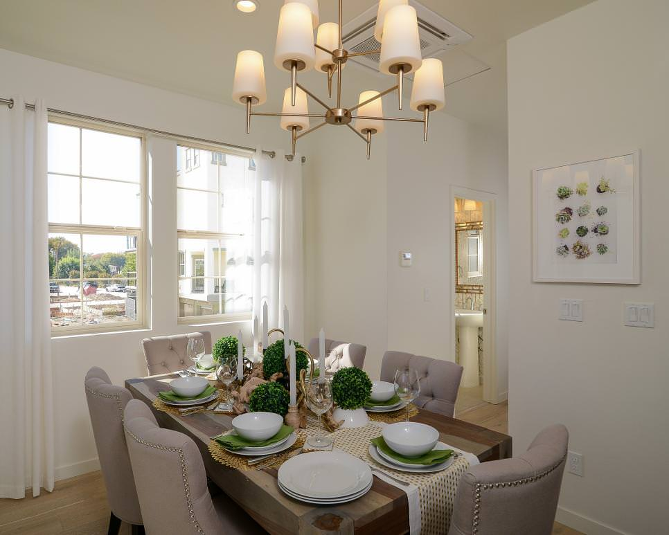 Tufted Neutral Chairs and Contemporary Chandelier