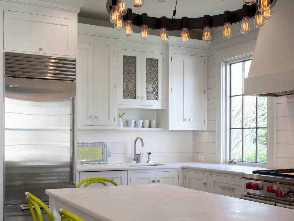 Contemporary White Kitchen With Circular Chandelier