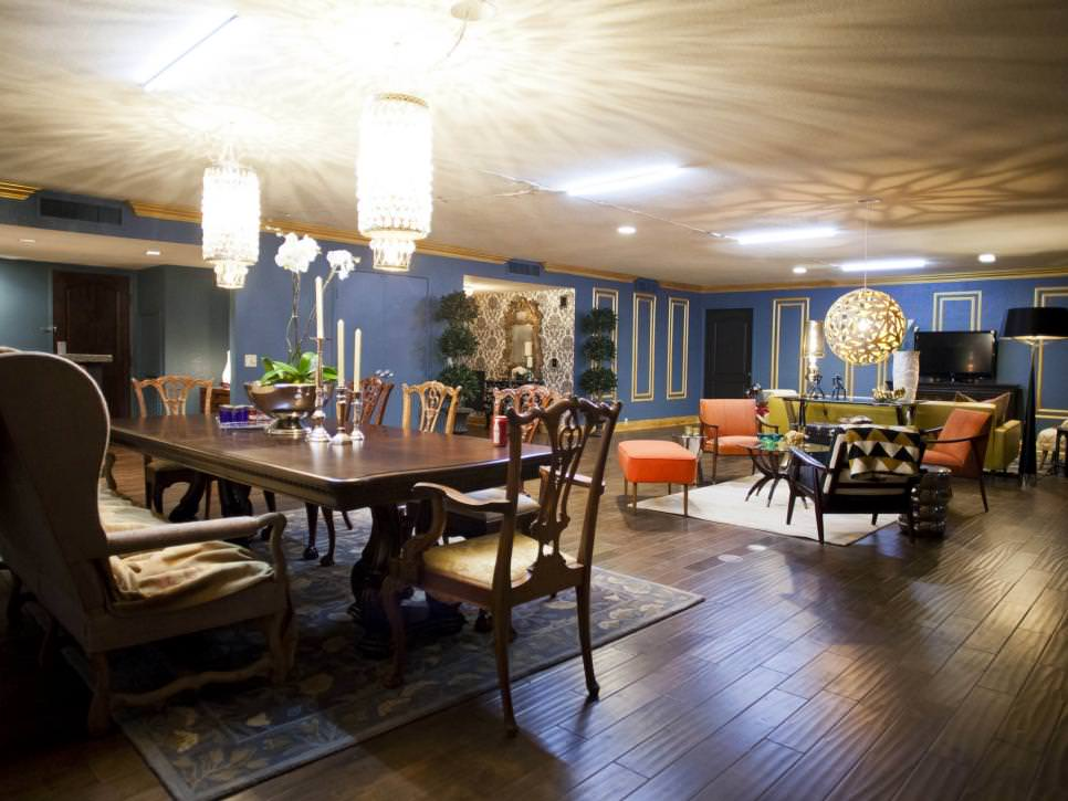 Blue Living and Dining Space With contempory Chandeliers