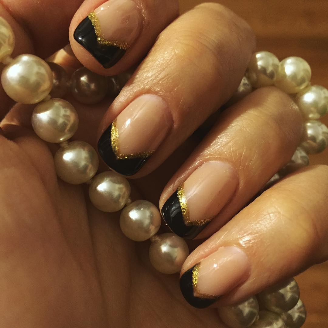 gold line black tip nail design