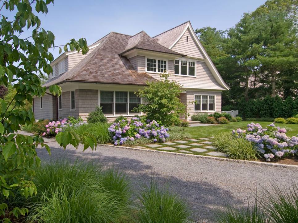 english country home exterior with purple hydrangeas