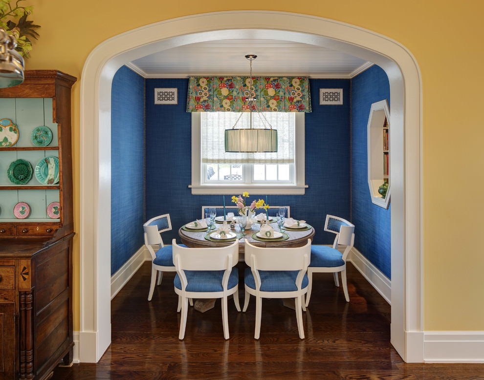 Bright blue dining room with royal chairs design
