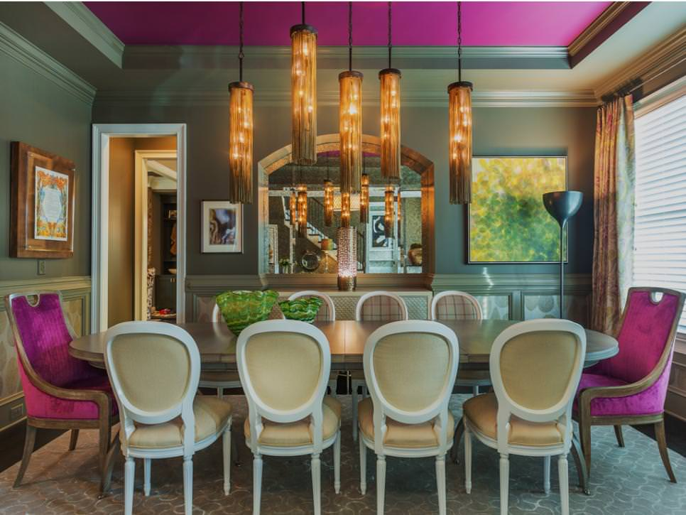 gray dining room with pink chairs