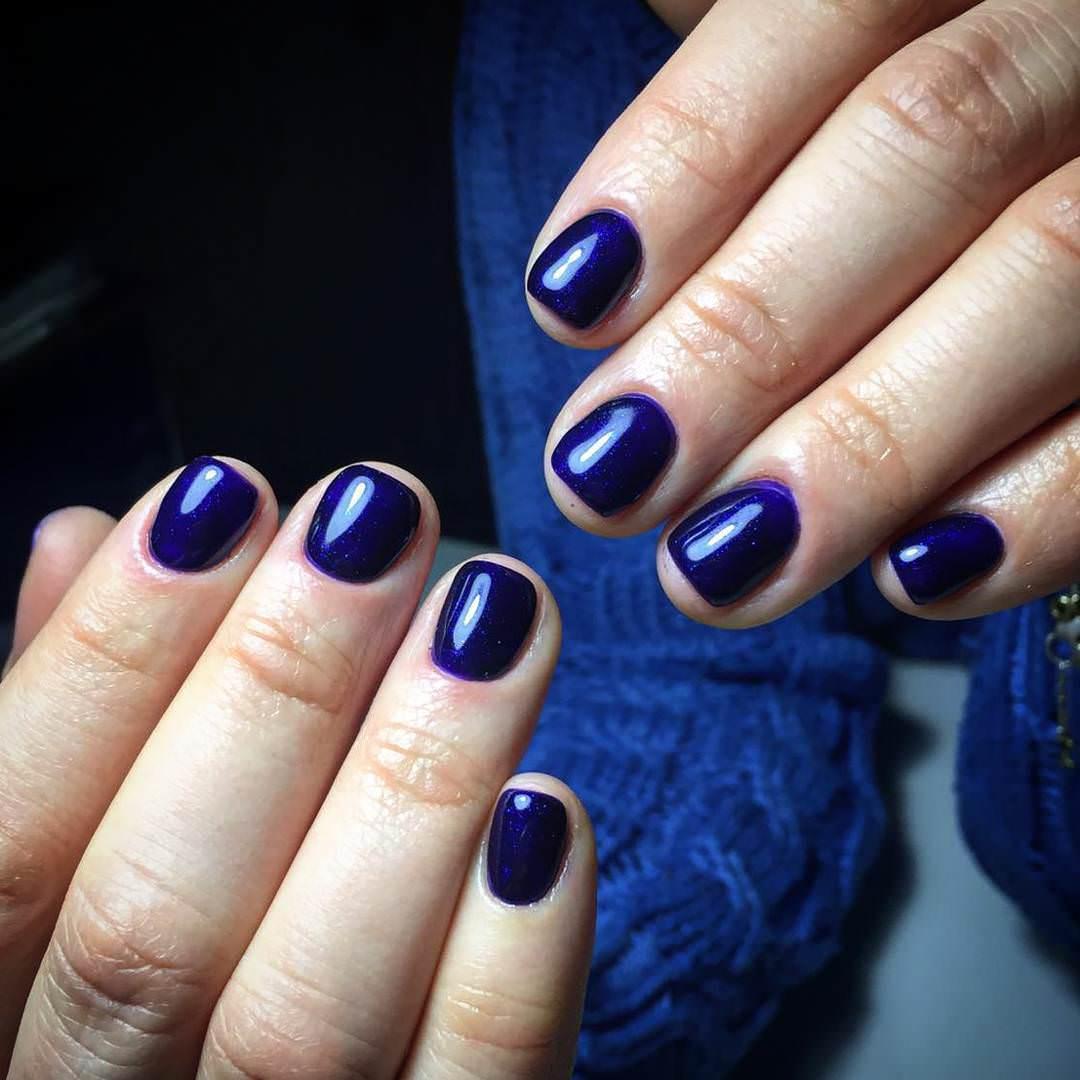 Glittering Dark Blue Nail Design