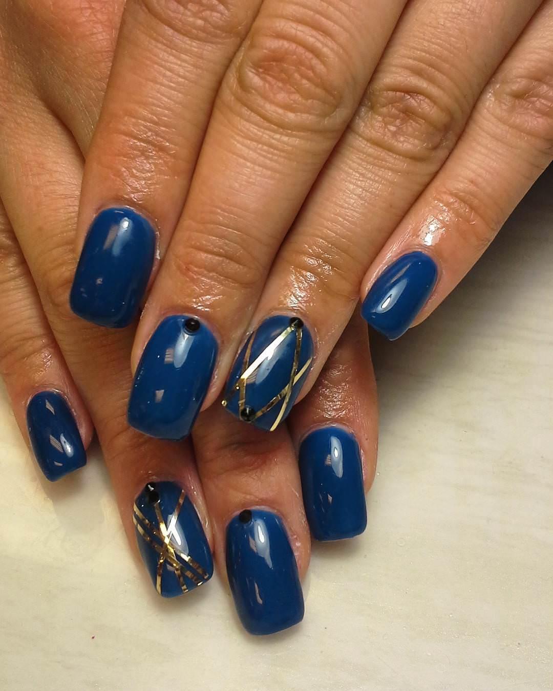 Gold Lines & Dark Blue Nail Design