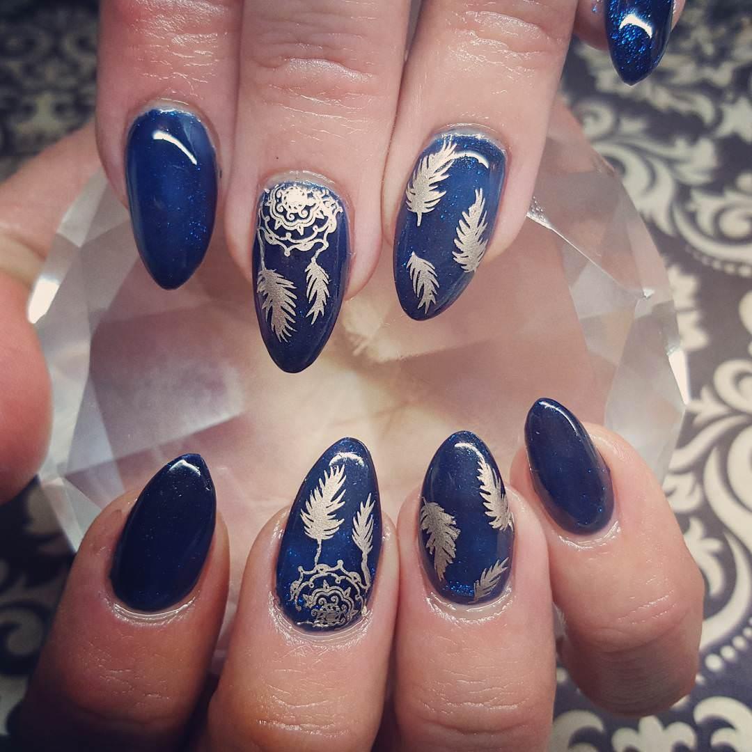 Leaf & Dark Blue Nail Design